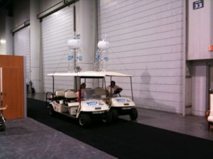 Golf carts that taxied attendees around the show. Yes, it was that huge!